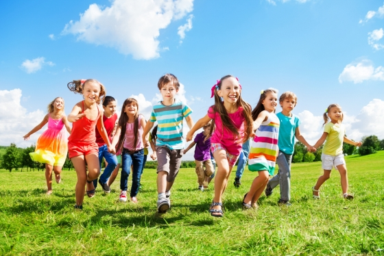 many-different-kids-boys-and-girls-running-in-the-park-on-sunny-summer-day-in-casual-clothes